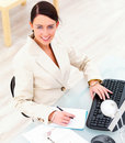 Young business woman at desk using computer Royalty Free Stock Photography