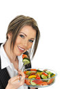 Young business woman eating a fresh mixed salad dslr royalty free image of attractive healthy with dark blonde hair off fork Stock Images
