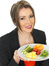 Young business woman with five a day food selection dslr royalty free image of an attractive dark blonde hair holding plate of her Royalty Free Stock Photography
