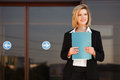 Young business woman with a folder Royalty Free Stock Photo