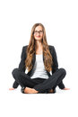 Young business woman with glasses sitting on floor in front of white background the maybe she is a businesswoman or laywer Royalty Free Stock Photos