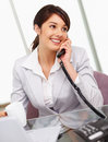 Young business woman having a phone conversation Stock Photo