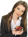 Young business woman holding a bowl of fresh mixed berries dslr royalty free image an attractive with dark blonde hair smiling Royalty Free Stock Image