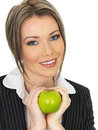 Young business woman holding a fresh ripe juicy green apple dslr royalty free image of attractive healthy delicious shiny crunchy Stock Photos