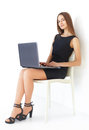 Young business woman with laptop beautiful sitting on chair working on white background Stock Image