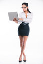 Young business woman with laptop smiling on white background Royalty Free Stock Photography