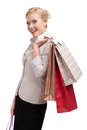 Young business woman in a light beige suit holding shopping bags Royalty Free Stock Image