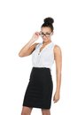 Young business woman looks over her glasses cut out image of a beautiful who while holding it Royalty Free Stock Image