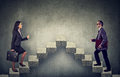 Young business woman and man stepping up a stairway career ladder Royalty Free Stock Photo