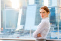 Young business woman on the modern city downtown background Royalty Free Stock Images