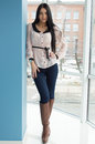 Young business woman at office window happy smiling beautiful standing gracefully Royalty Free Stock Image