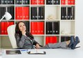 Young business woman is resting in workplace in the office break Royalty Free Stock Photos