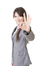 Young business woman showing ok sign on the white background Stock Photography