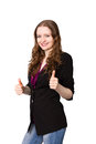 Young business woman shows thumbs up smiling sign Royalty Free Stock Photos