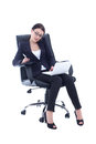 Young business woman sitting on chair, working with laptop and t Stock Photography