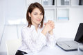 Young business woman sitting at desk at office Royalty Free Stock Photo