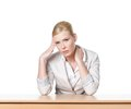 Young business woman sitting at a office desk Stock Photography
