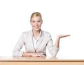 Young business woman sitting at a office table Royalty Free Stock Image