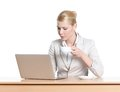 Young business woman sitting at a office table with laptop Royalty Free Stock Photography