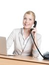 Young business woman sitting with phone handset Stock Photos