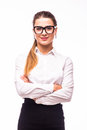 Young business woman smiling, standing with arms crossed over white background Royalty Free Stock Photo