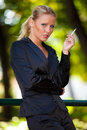 Young business woman smoking cigarette Royalty Free Stock Photo