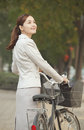 Young business woman standing with a bicycle beijing china Stock Photography