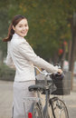 Young business woman standing with a bicycle beijing china Royalty Free Stock Photography