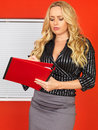 Young business woman taking notes a dslr royalty free image of attractive secretary with blonde long hair concentrating minutes Stock Images