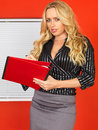 Young business woman taking notes a dslr royalty free image of an attractive secretary with long blonde hair or minutes for a Royalty Free Stock Photography