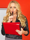 Young business woman taking notes holding red folder a dslr royalty free image of attractive with blonde wavy hair standing with Royalty Free Stock Images