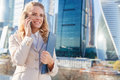 Young business woman talking on phone near modern office building Royalty Free Stock Photo