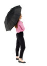 Young business woman under an umbrella rear view people collection backside view of person isolated over white background a girl Stock Image