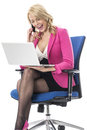 Young Business Woman Using a Laptop Computer and Mobile Cell Phone Royalty Free Stock Photo