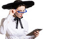 Young business woman using tablet pc and wearing glasses and futuristic hat portrait of in studio over white background Royalty Free Stock Photography