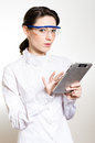 Young business woman using tablet pc and wearing glasses girl in studio over white background Stock Images