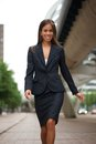 Young business woman walking in the city portrait of a Royalty Free Stock Photo