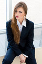 Young business woman wearing man s suit in office businesswoman looking bossy Stock Photography