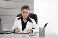 Young business woman working in the office Royalty Free Stock Image