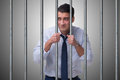 The young businessman behind the bars in prison Royalty Free Stock Photo