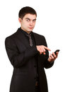 Young businessman with cellphone Royalty Free Stock Photos