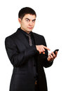 Young businessman with cellphone showing finger surprise to phone Royalty Free Stock Image