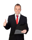 Young businessman with a clipboard saying Ok Royalty Free Stock Photography