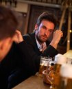 Young businessman drunk in pub portrait of drinking too much beer looking confused Stock Photo
