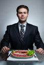 Young businessman eating Stock Image