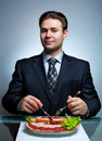 Young businessman eating Stock Images