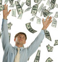 The young businessman falling dollars Royalty Free Stock Photo