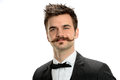 Young businessman with fancy mustache and black tie isolated over white background Royalty Free Stock Photo