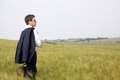 Young businessman in field aspiring standing a thinking about starting a business Stock Photo