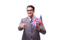 The young businessman with flag isolated on white